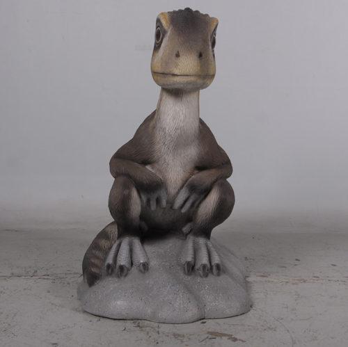 Théropode bébé assis 170204 nlc déco deco animaux en résine dinosaure